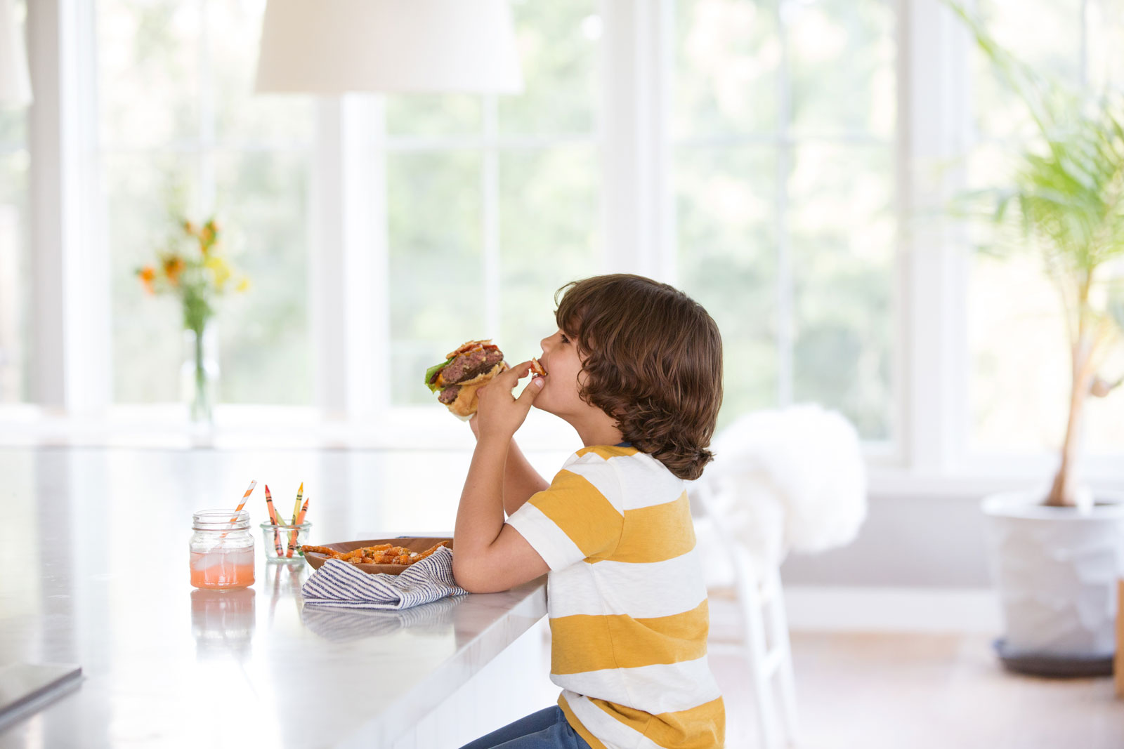 Lifestyle Food Image of Boy eating  | Trinette+Chris Photographers