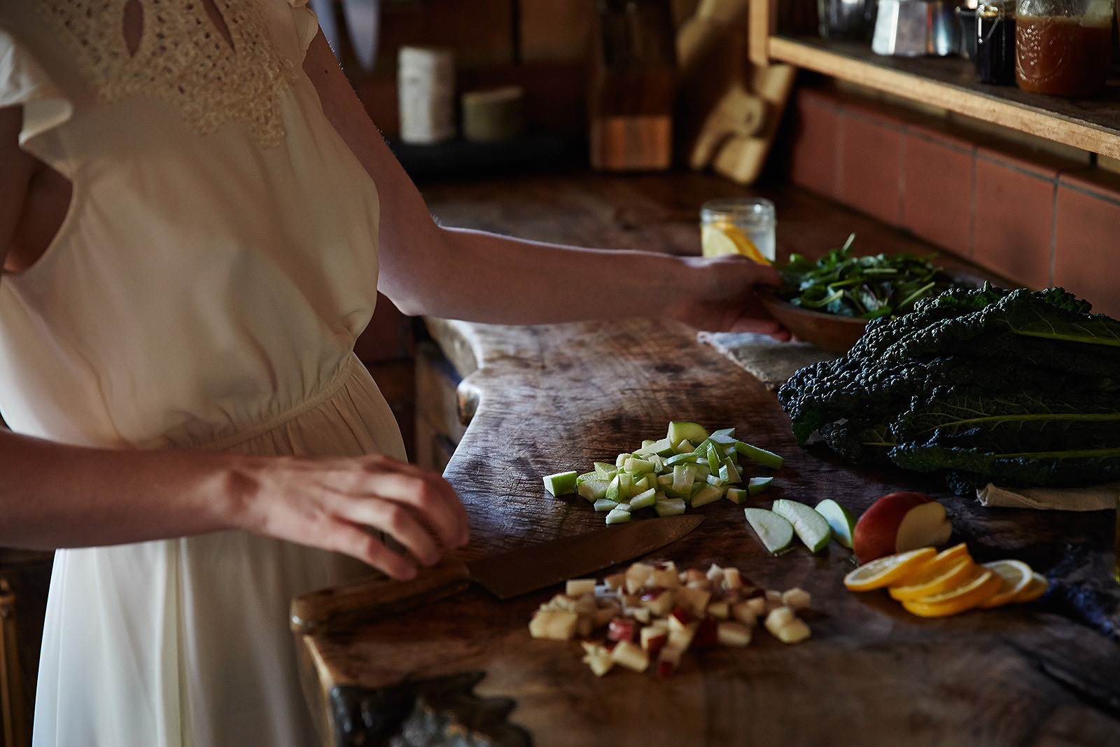 Woman cooking in rustic kitchen  | Trinette+Chris Photographers