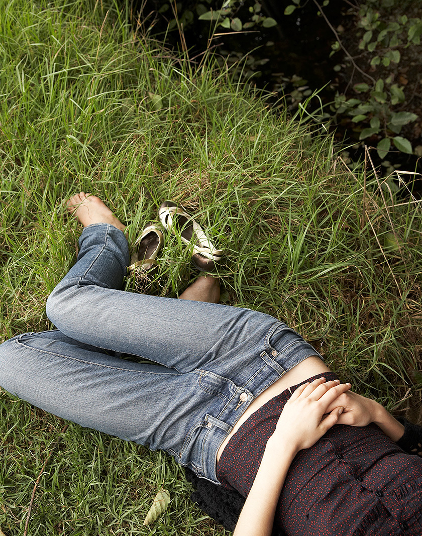 Woman relaxing in grass in CA  | Trinette+Chris Photographers