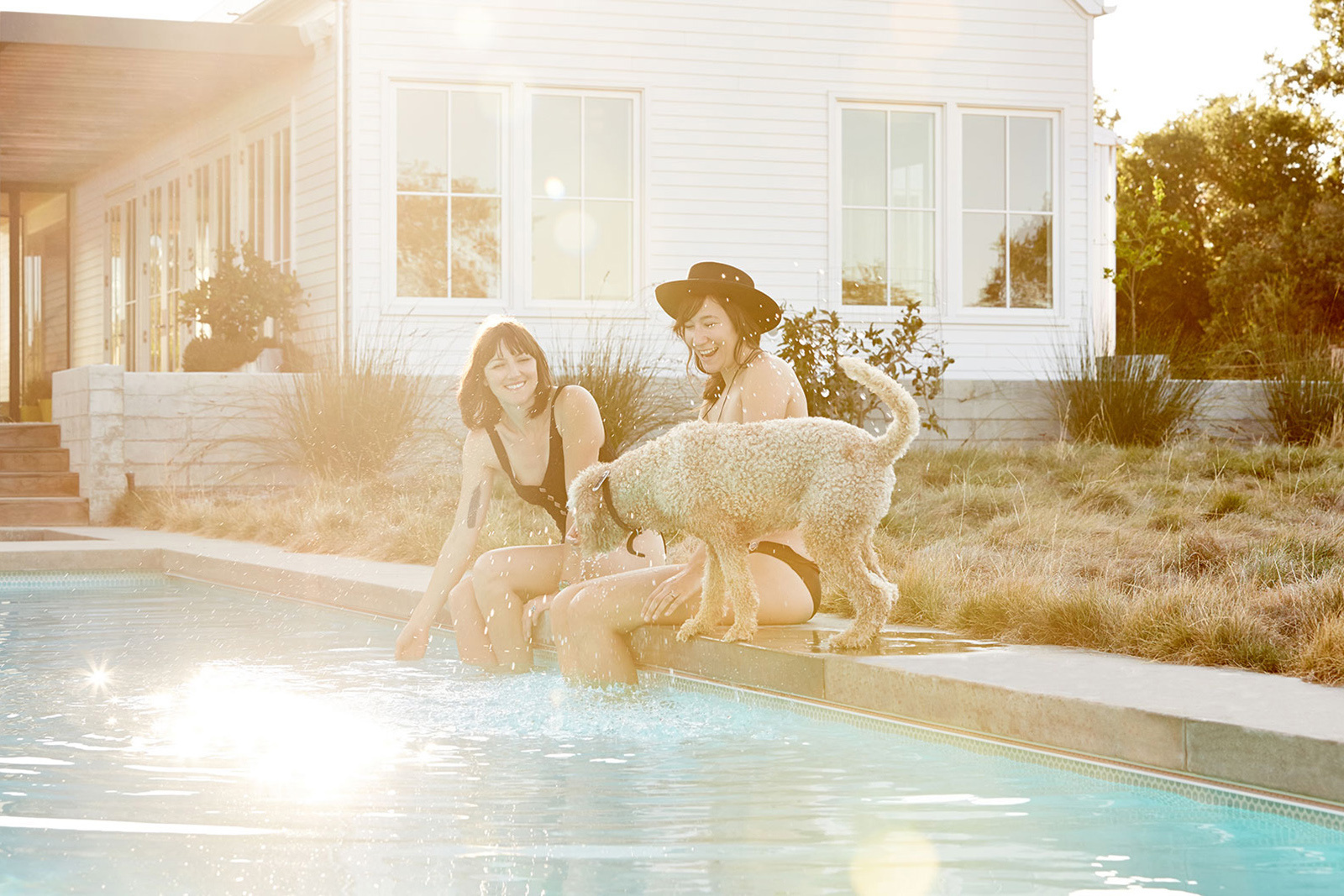 Friends with dog at pool  | Trinette+Chris Photographers