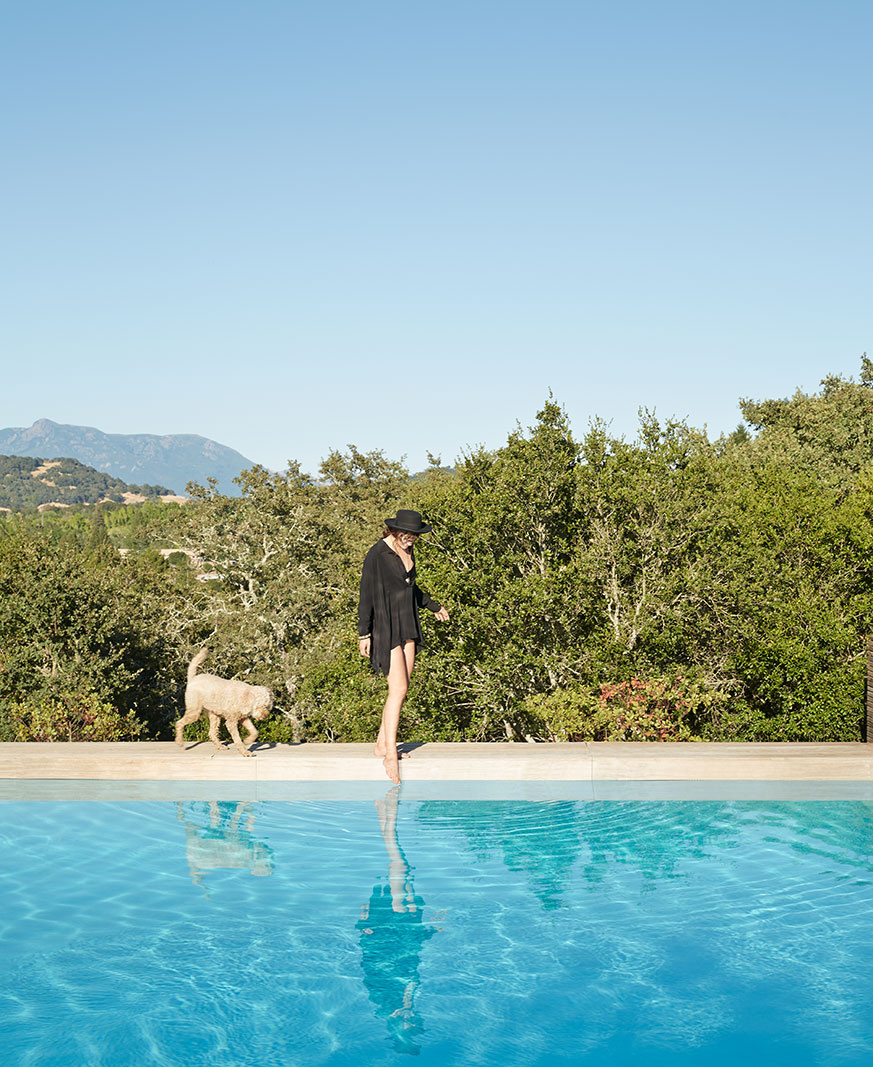 Woman with dog at pool  | Trinette+Chris Photographers