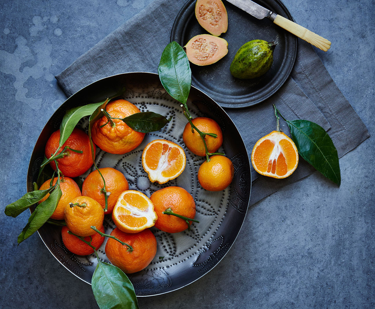 Oranges on grey concrete surface | Trinette+Chris Photographers