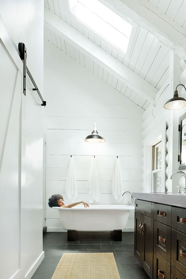 Woman in modern design bathroom  | Trinette+Chris Photographers